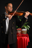 Romantic Restaurant. A violinist playing in a romantic French restaurant royalty free stock photography