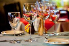 Romantic restaurant interior. served table with wine glasses and plates Stock Photos