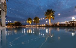 Romantic restaurant by the pool at night. Reflection in water stock image
