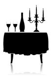 Romantic restaurant table. Silhouette romantic restaurant table with tablecloth, wine glasses, wine and candelabrum Stock Photos