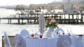 Romantic Restaurant Table by the Sea Stock Photos