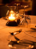 Romantic restaurant table setting. Of cutlery and glasses Royalty Free Stock Photos