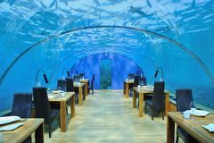 Romantic Restuarant. The most romantic restaurant in the world. Maldives Conrad hotel restaurant. the restaurant is under the ocean. many fishes around the Stock Photos