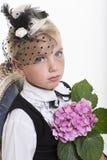 Romantic retro girl with flower Stock Photography