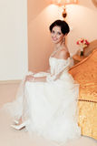 Romantic rich happy girl in bridal dress smiling have final preparation for wedding Stock Images
