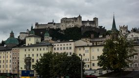 Castle of salzburg on hilltop with ancient city in front royalty free stock images
