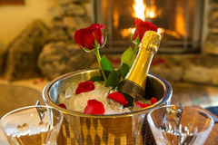 Romantic room with champagne bucket and roses Stock Photos