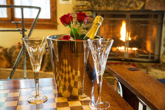 Romantic room with champagne bucket and roses Stock Photo