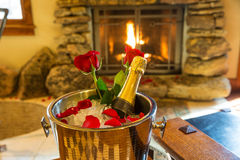 Romantic room with champagne bucket and roses Royalty Free Stock Photo