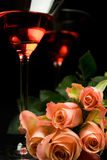 Romantic rose with Glasses. Of Campari over black Royalty Free Stock Images
