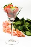 Romantic rose with strawberries. In glass over white Royalty Free Stock Image