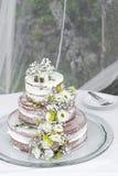 Romantic rustic floral design wedding cake on table outdoors. Romantic rustic pastel floral design wedding cake on table outdoors stock photography
