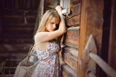 Romantic sad girl near wooden wall Stock Images
