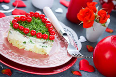 Romantic salad shaped heart on Valentines Day Stock Photography
