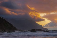 Romantic and at the same time dramatic sunset on Benijo beach in. Tenerife royalty free stock photo
