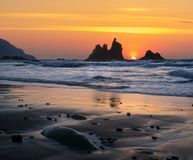 Romantic and at the same time dramatic sunset on Benijo beach in. Tenerife stock photo