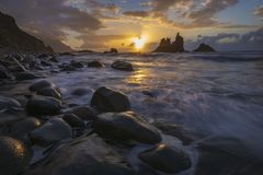 Romantic and at the same time dramatic sunset on Benijo beach in. Tenerife stock photography