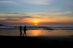 Romantic scene of a couple silhouette and sunset background Stock Images