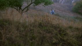 Romantic scene of couples foggy day on the road. The general outline of the autumn landscape. The guy and the girl walk on the nature. Ukraine stock footage