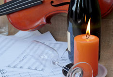 Romantic scene with fiddle and sheet music Stock Image