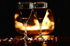 Romantic scene with glasses of wine Royalty Free Stock Image