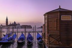 Romantic scenery of gondolas in Venice. Sunset over San Giorgio Maggiore and deserted gondolas pier Royalty Free Stock Photos