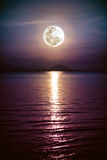 Romantic scenic with full moon on sea to night. Reflection of mo Stock Images