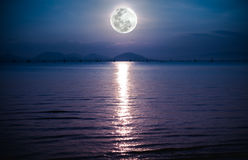 Romantic scenic with full moon on sea to night. Reflection of mo Royalty Free Stock Photos