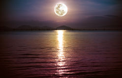 Romantic scenic with full moon on sea to night. Reflection of mo Stock Photography