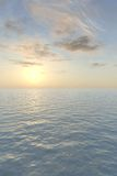 Romantic Sea View. The blazing sun sets with a glowing peach-colored haze over a calm, tropical sea in this vertical image. A nice background for a greeting card stock illustration