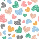 Romantic seamless pattern with cute colored hearts. Drawn by hand. Vector illustration stock illustration