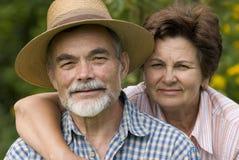 Romantic senior couple 2. Happy elderly couple embracing outdoors Stock Images