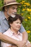 Romantic senior couple. Happy elderly couple embracing outdoors Stock Image