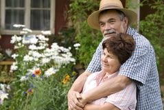 Romantic senior couple. Happy elderly couple embracing outdoors Royalty Free Stock Image