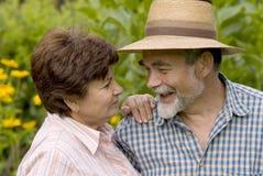 Romantic senior couple. Happy elderly couple embracing outdoors Stock Photography