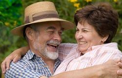 Romantic senior couple. Happy elderly couple embracing outdoors Royalty Free Stock Photo