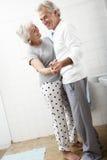 Romantic Senior Couple In Bathroom Stock Image