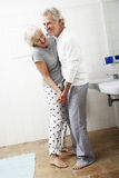 Romantic Senior Couple In Bathroom Royalty Free Stock Photo