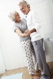 Romantic Senior Couple In Bathroom Royalty Free Stock Images