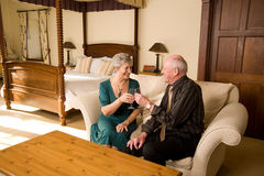 Romantic senior couple celebrating Royalty Free Stock Photography