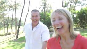 Romantic senior couple holding hands  stock video footage