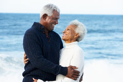 Romantic Senior Couple Hugging On Beach Stock Photo