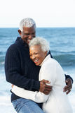 Romantic Senior Couple Hugging On Beach. Smiling Stock Photography