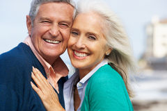 Romantic Senior Couple Hugging On Beach. Smiling Stock Photo