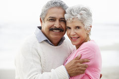 Romantic Senior Couple Hugging On Beach Stock Photos
