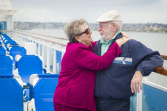 Romantic Senior Couple Hugging on The Deck of a Cruise Ship Stock Photo