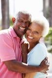 Romantic Senior Couple Hugging In Street royalty free stock photos