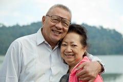 Romantic senior couple on lake stock images