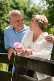Romantic senior couple laughing outdoors Royalty Free Stock Images