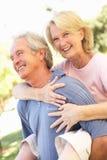 Romantic Senior Couple In Park stock photo